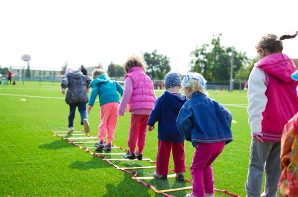 Children's Team Building on Green Grassland