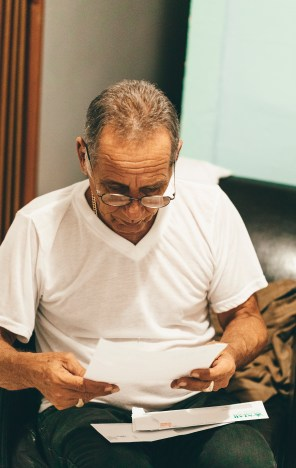 Photo Of Old Man Reading Paper