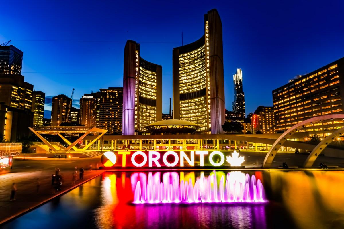Powered-on Toronto Neon Sign Near Water Fountain