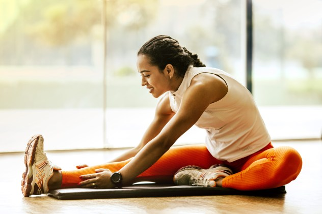 Woman Stretching on Ground healthy lifestyle