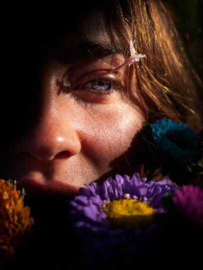 Flowers Near Woman's Face