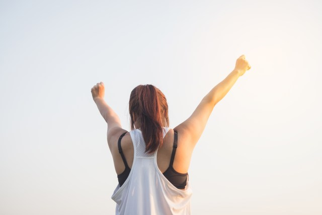 Woman Wearing Black Bra and White Tank Top Raising Both Hands on Top overcome glossophobia