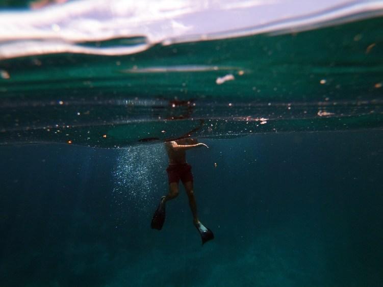 Man in Black Shorts in Water