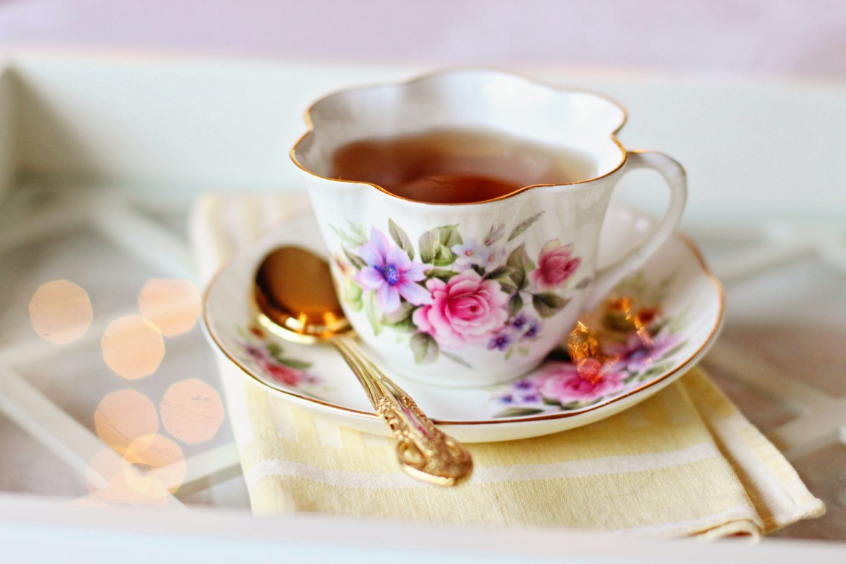 Selective Focus Photo of Teacup Filled With Tea