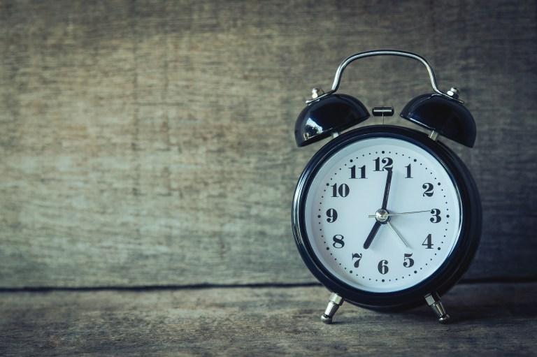 Black Analog Alarm Clock at 7:01