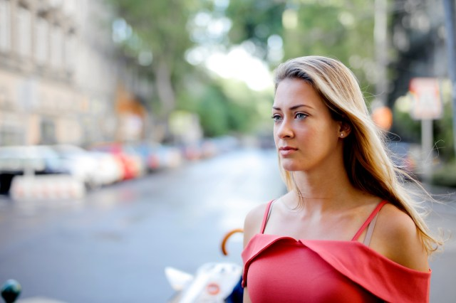 Selective Focus Photo of Woman in Red Top