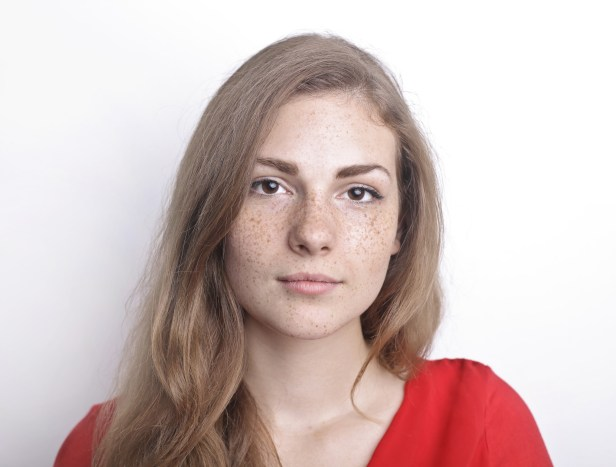 Portrait Photo of Woman With Freckles in a Red Top