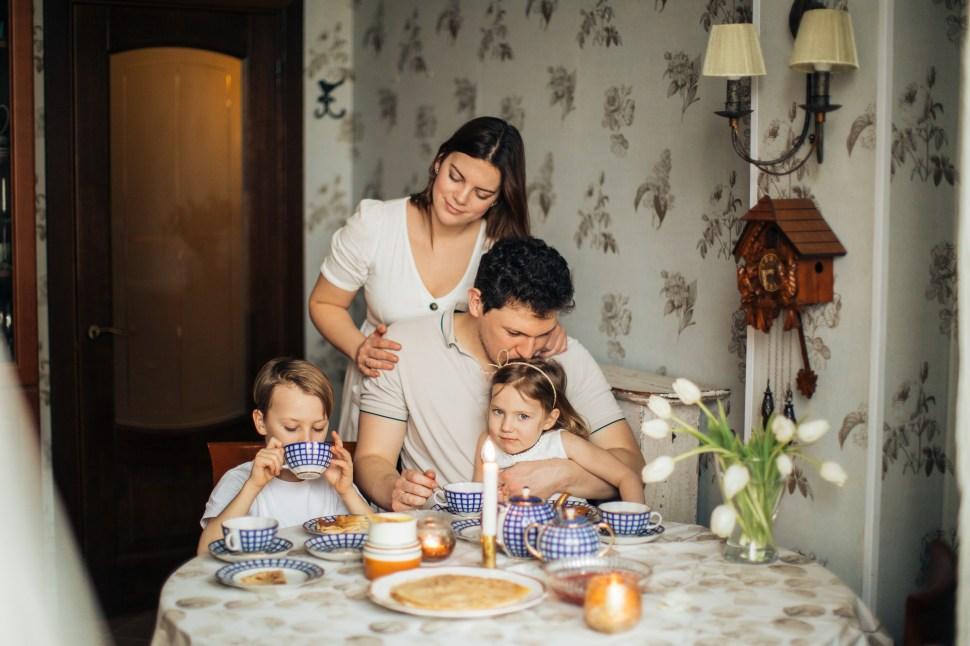 Cheerful family drinking tea at home