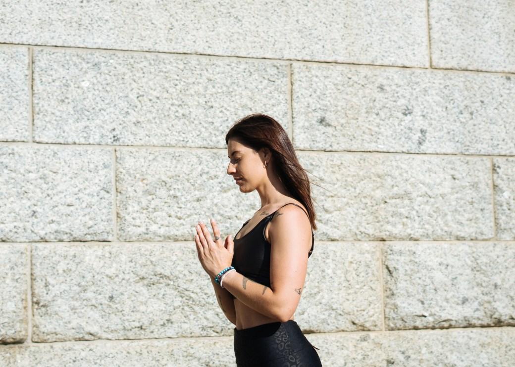 Woman Standing Near Concrete Wall