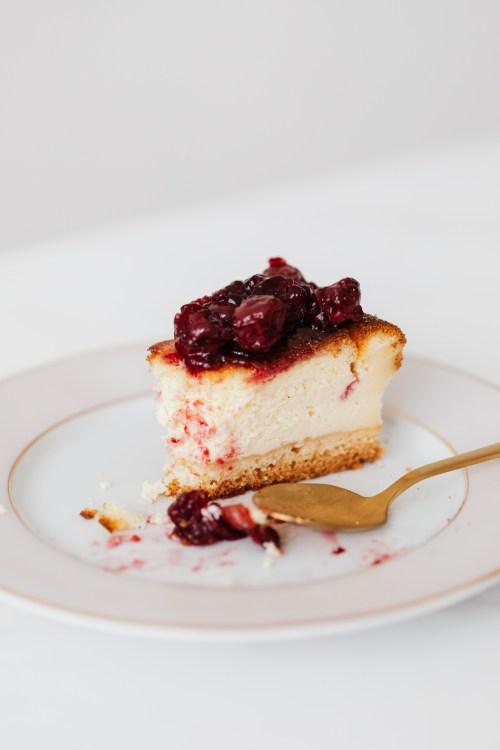 Bitten piece of berry cheesecake