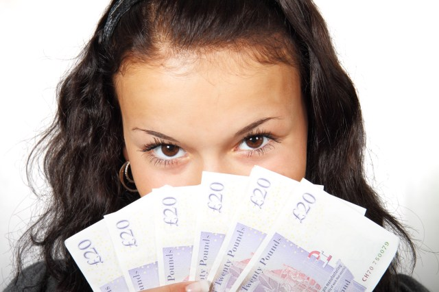 Money Myths That Can Cost You Dearly - female with twenty pound notes