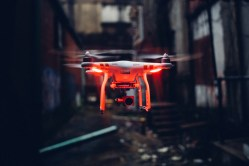 Flying UAV with red lamps in grunge yard