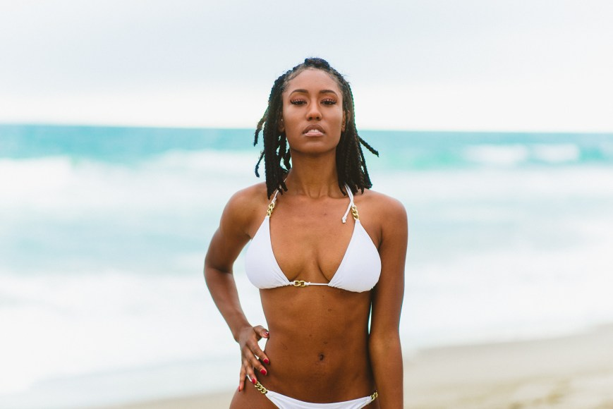 Woman Wearing Bikini Standing in Front of Body of Water