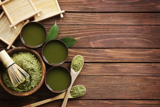 moringa powder in a bowl with green tea next to it