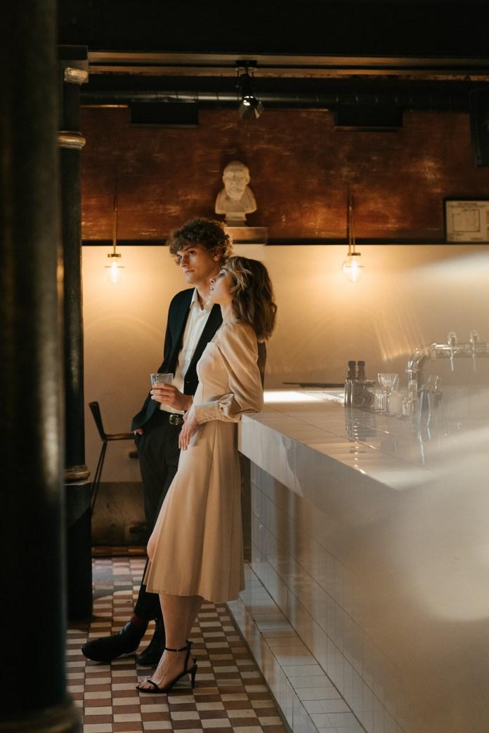 https://www.pexels.com/photo/woman-in-beige-coat-standing-beside-mirror-4694566/