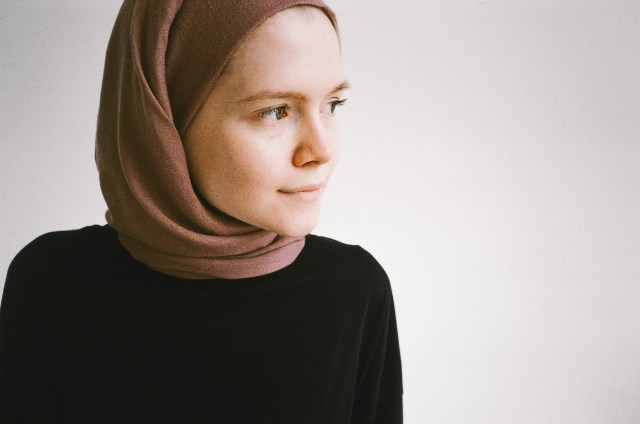 Woman in Brown Hijab and Black Long Sleeve Shirt