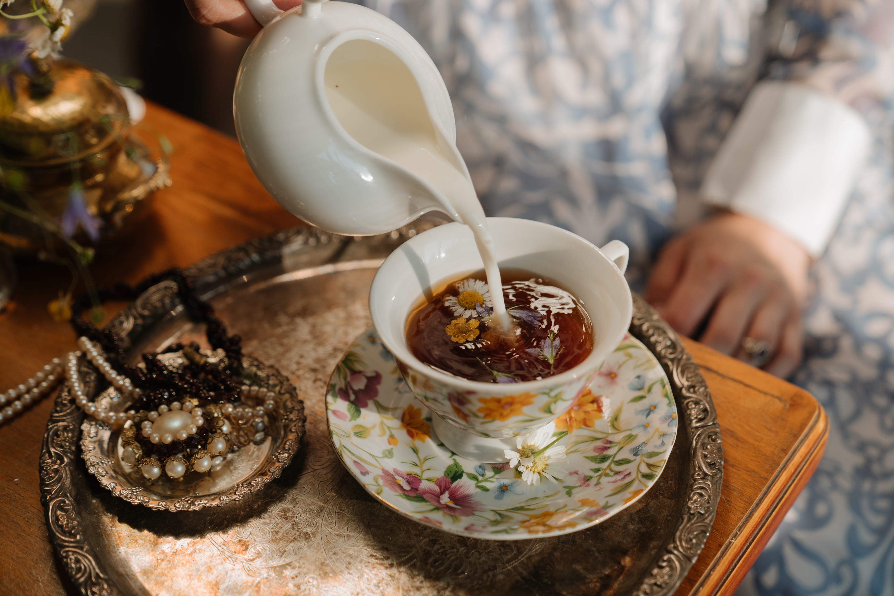 Milk being poured into tea
