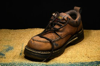 Brown and Black Leather Work Boots on Brown Surface