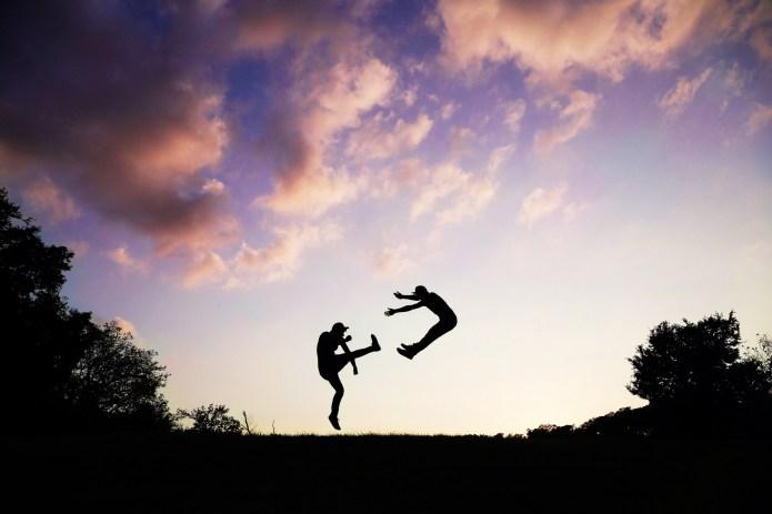 2 People Doing Karate during Sunset