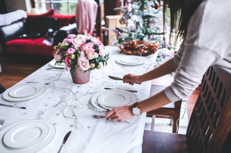 Woman Preparing Christmas Table