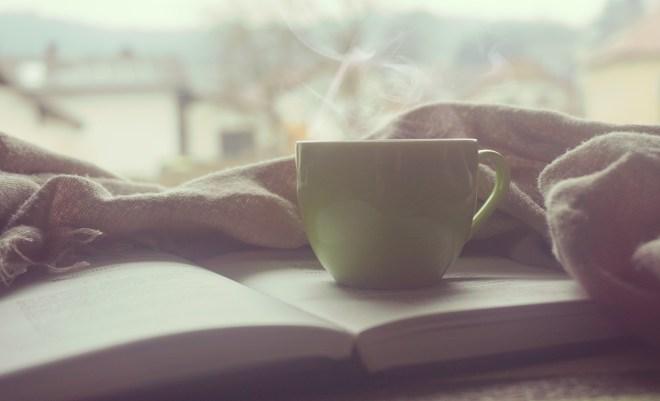White Hot Mug on Book Near Linen