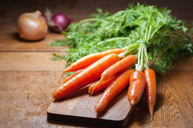8 Piece of Carrot on Brown Chopping Board
