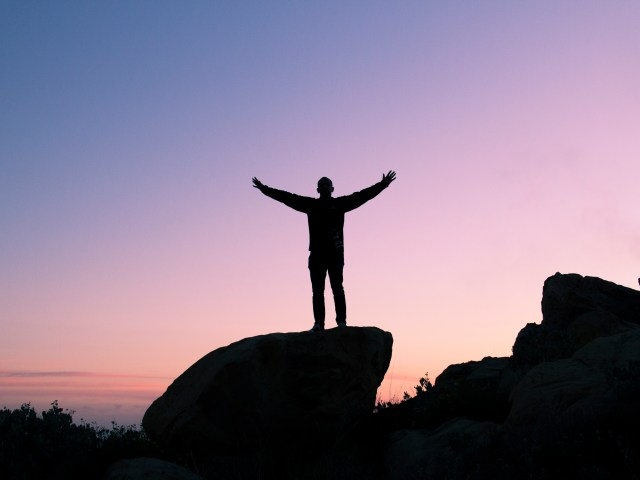 Silhouette of Man Raising His Hands