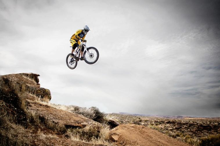 Person Riding Bike Making Trek on Thin Air