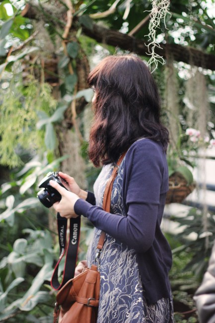 Woman In Blue Cardigan Holding Canon Dslr Camera Free