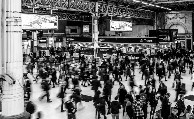 Grayscale Photography of People Walking in Train Station