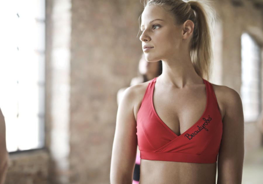 Photo of Woman in Red Sports Bra