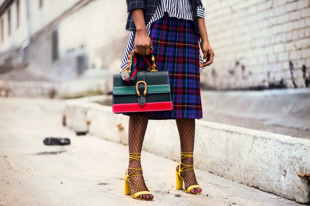 Woman Holding Green and Red Leather Handbag