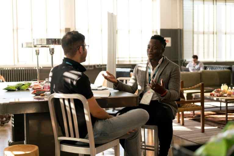 Photo of Men Having Conversation