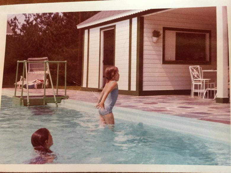 Young Monica Kline in the pool