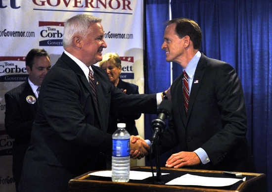 Republican candidates, Corbett and Toomey, shake hands at Penn State rally.