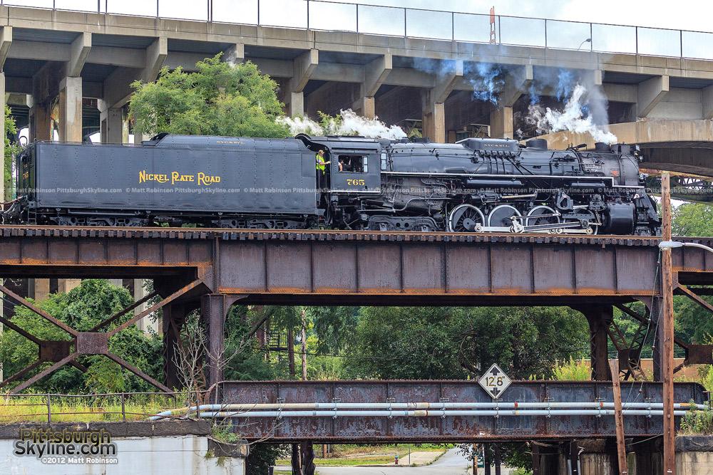765 crosses a stack of Pittsburgh bridges