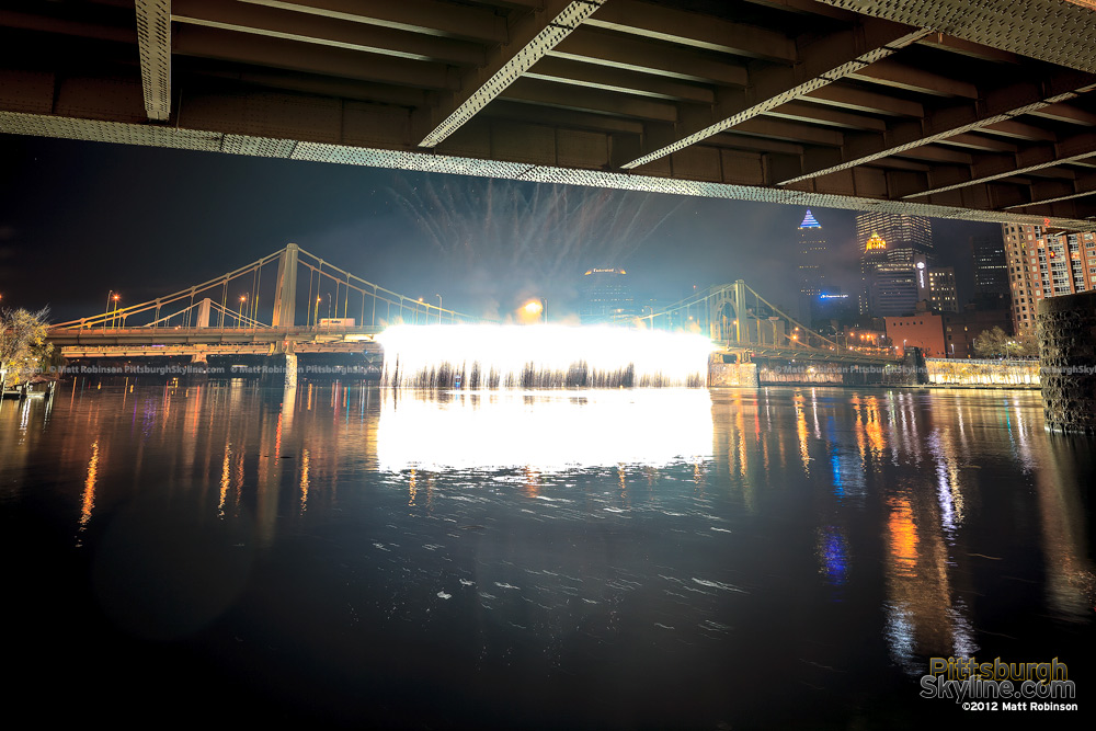 Waterfall fireworks stream brightly of the Andy Warhol Bridge during light up night Pittsburgh