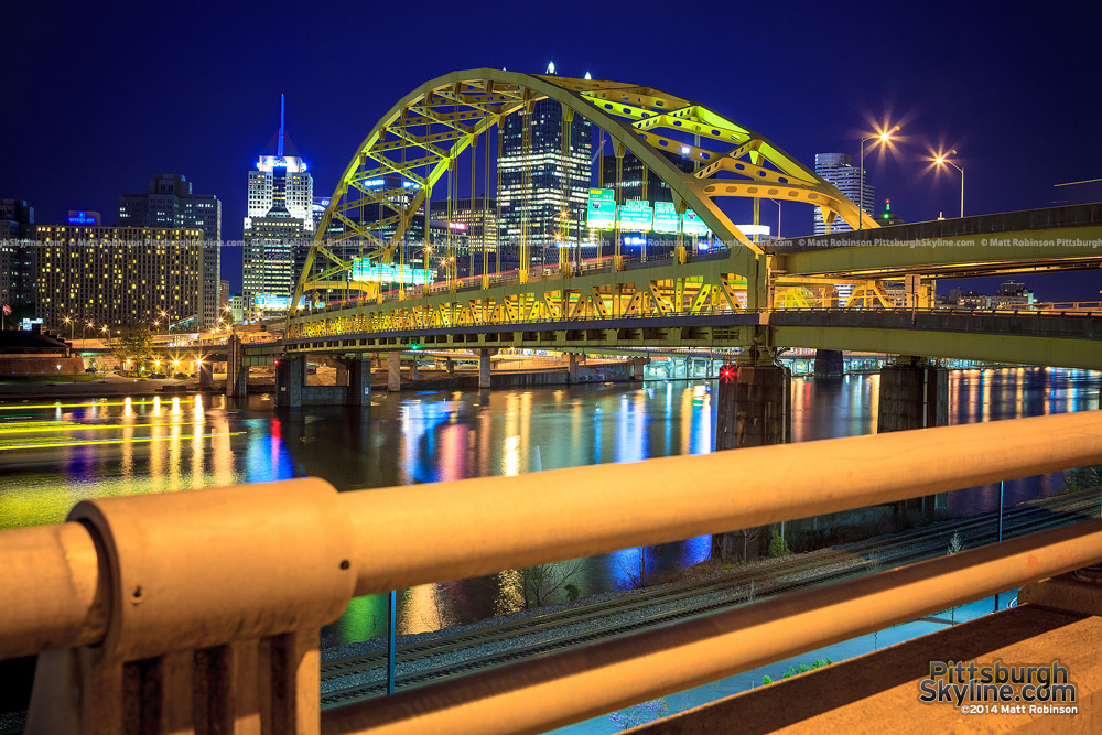 The Pittsburgh Skyline at night with the Fort Pitt Bridge