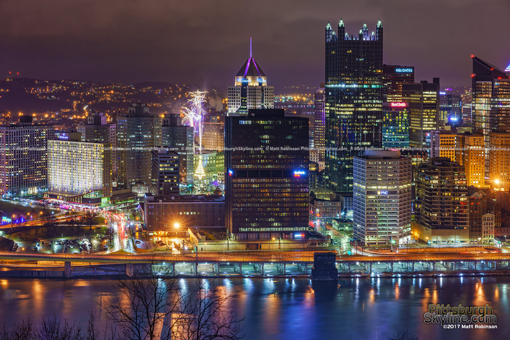 Fireworks blast off from Penn Plaza in downtown Pittsburgh