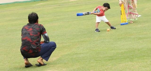 Father-son bowling-batting.  Mushfiqur's wife Jannatul Kifayat was the fielder in this 'match'.