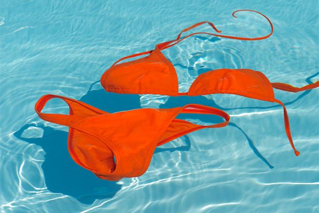 Orange bikini floating in the pool