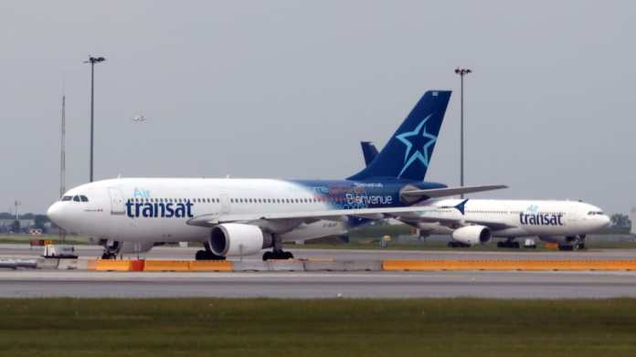 Two aircraft in the colors of Air Transat.