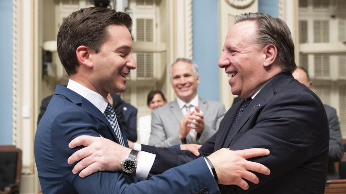 The Minister of Immigration and CAQ House Leader Simon Jolin-Barrette and Prime Minister François Legault welcome the adoption of PL 21 on Sunday night at Salon Bleu.