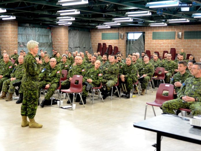 Major-General Carignan addressing a Canadian military audience in a barracks.