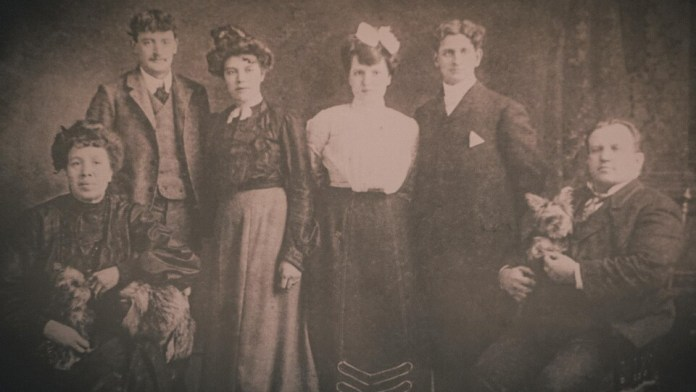 A vintage family photo in black and white
