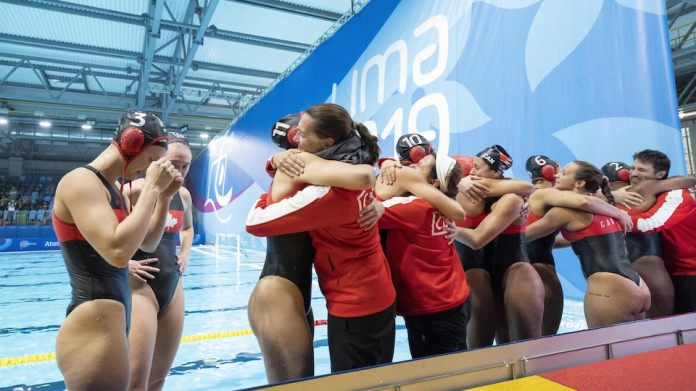 The players are hugging on the edge of the pool.