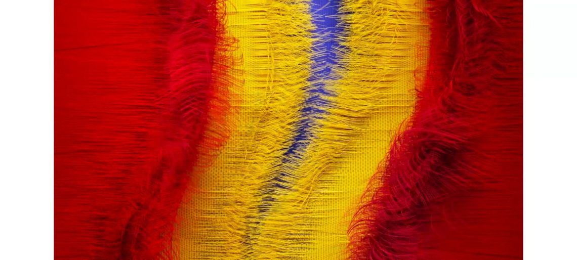 A video is showing by multiple layers of primary colored burlap material being torn down the middle. It then shows QLED contrast ratio through various primary colors of paint being splashed with black background.