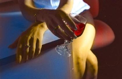 Generic pic of a woman holding a glass of red wine.
