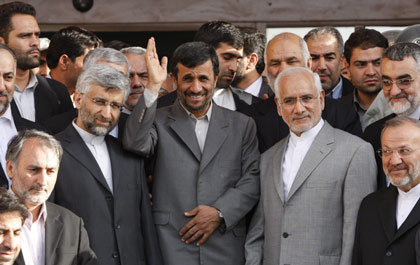 Mahmoud Ahmadinejad, centre, with nuclear officials this month.