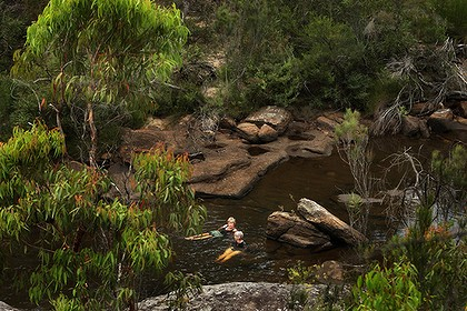 Sharyn Cullis the secretary of the Georges River environmental alliance (left) and Pat Durman an executive member of the National Parks Association (NPA) Macarthur branch (right) swims in O'Hares Creek, at a swimming spot called Cobong in the Dharawal State Conservation area